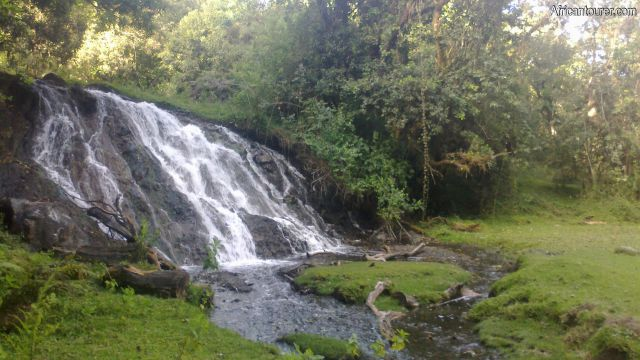 Maio waterfalls Arusha national park, up close - a view from the western end with picnic area to the right