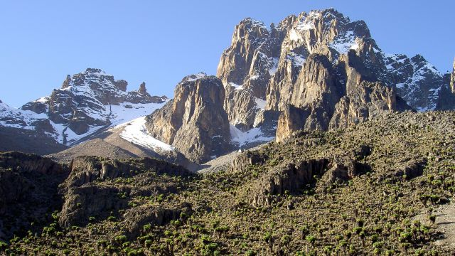 Nelion peak of mount Kenya , (leftmost on the right tower) with Batian to its right and point Thompson on the left (separate) [1]