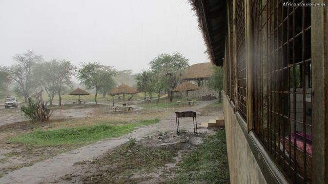 Nguchiro Campsite of Serengeti national park, 'on a rainy day', the kitchen (near right) with toilets in the distance
