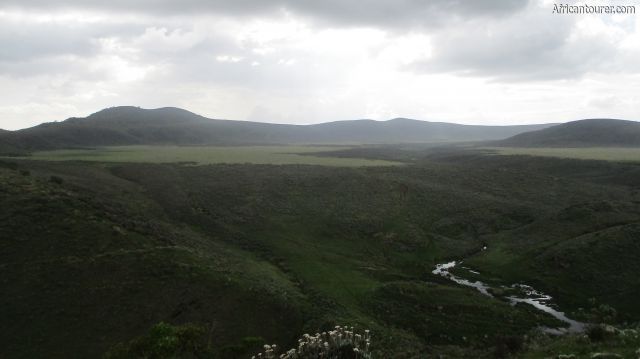 Olmoti crater of Ngorongoro conservation area, as seen from a point on is rim - end of entrance path