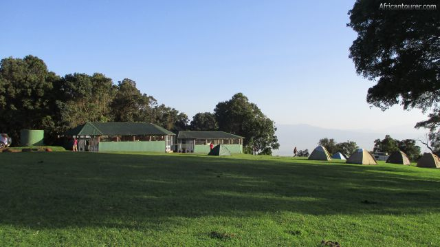 Simba A campsite of Ngorongoro conservation area, kitchen and dining (left), with tents on the right - as seen from the gate