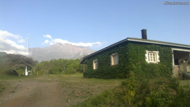 tanapa (arusha) rest house, as seen from the entrance road in the morning